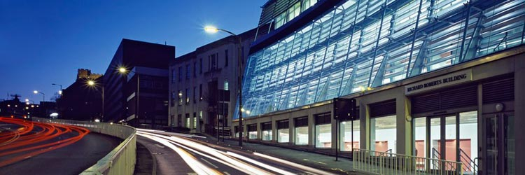 The Dainton Building and the Richard Roberts building at night - click to entry site